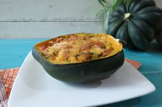 Baked Stuffed Acorn Squash - A sweet and savory baked acorn squash stuffed with an apple and chicken sausage stuffing.