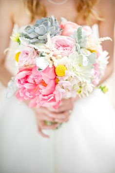 bridal bouquet with coral peonies, stock, astilbe, dusty miller, succulents, billy balls and dahlias. www.hautefloral.com