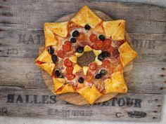 """Dans le cadre de notre série """"Les petites recettes de la rédac'"""", découvrez comment réaliser une belle pizza en forme d'étoile."""
