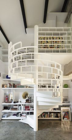 White modern spiral stair. Way cool design. I love sculptural architecture.  Simple concrete floor.