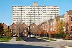 Old Town Village West townhomes, a new mixed-income development, ca. 2009; looming in the background is the William Green Homes high-rise, part of Cabrini-Green, demolished 2011. (interesting high rise being replaced by trad. houses)