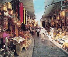 Souk. Hammamet, Tunisia. I came here and loved the many textiles and goodies. The vendors were like vultures! Sept 2011