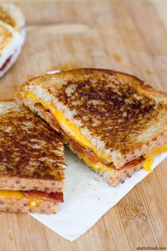 This grilled cheese is filled with sharp cheddar, crispy bacon, and crisp apples! It feels gourmet, but is so simple to make! | www.alattefood.com