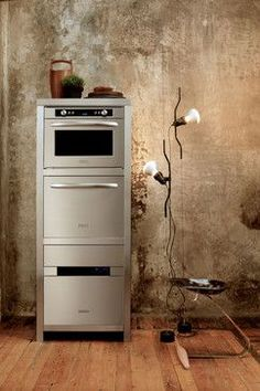 stack of built-in appliances from KiitchenAid, a steam oven, a small dishwasher and a wall oven.