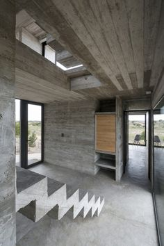 Image 16 of 27 from gallery of Golf House / Luciano Kruk Arquitectos. Photograph by Daniela Mac Adden Concrete Staircase, Concrete Architecture, Concrete Houses, Residential Architecture, Interior Architecture, Interior Design, Interior Wood Shutters, Concrete Interiors, Beton Design