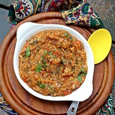 Baigan Bhartha, an easy and super flavorful recipe for Smokey Eggplant puree with tomatoes.