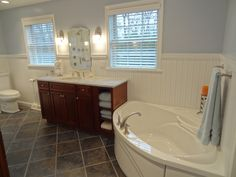 Lisa Scheff Designs - Think of relaxing in this massive tub after a long day! Sounds pretty perfect to me.