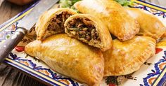 Looking for something simple and delicious to make for a hungry crowd? These mouthwatering Mini Beef Empanadas are EXACTLY what you need then! With minimal ingredients and only 4 simple steps, these bad boys will put a smile on everyone's face. The crisp, buttery outside combined with the flavorful, succulent inside will satisfy the toughest …