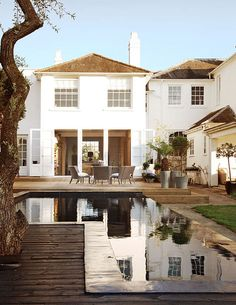From the French doors, the terrace to the pool. This gives the effect of an all-in-one space. Photo: Dominic Blackmore