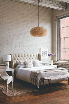 brick wall adds fun texture to a room