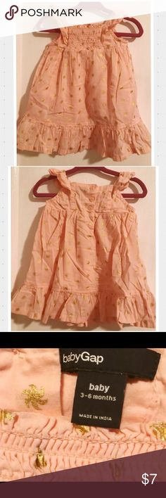 Baby Gap Dress 3-6 Months Baby Gap Pink and Gold Stars (looks more like truffulas) Dress size 3-6 Months. Excellent condition. No rips, tears or holes. Please see pics for details. Thanks for looking! Baby Gap Dresses Casual
