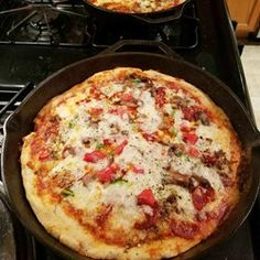 "Deep-Dish Cast Iron Pizza Recipe - ""A buttery, thick, and chewy pizza dough that is baked in a cast iron skillet. Pizza never tasted so good! Toppings are substantial but not overwhelming where the dough won't cook. If you cook the sausage while the dough is proofing you'll be ready to assemble the pizza that much faster."""