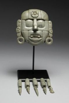 Mask with Pendant Beads, Guatemalan (Maya style), Guatemala, AD 250-850 (Classic (?)), jadeite. Mask H: 5 13/16 x W: 5 13/16 x D: 1 15/16 in. (14.8 x 14.7 x 4.9 cm)  The John Bourne Collection Gift. Walters Art Museum