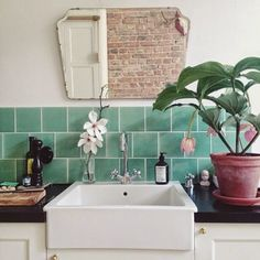 A soft, teal green is the perfect color for a modern bathroom or laundry room sink.