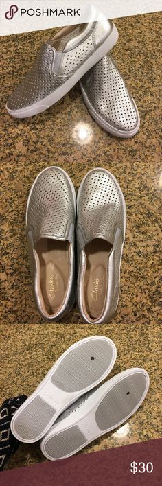 Sample sale! Clarks silver slip ons 7.5 Grab these samples with just one minor flaw for a bargain. Small hole punched in under side. Totally wearable I have many shoes with this hole. Brand new otherwise. Clarks Shoes Sneakers