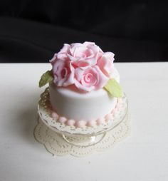 Miniature Pink Roses Topped White Cake