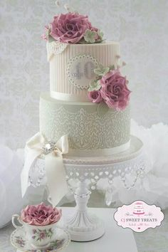 Romantic cake..love the lace and stripes..hate the flowers