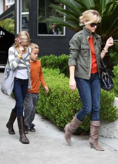 love her look (love army green w/ orange) ..& even has the kids looking cute :) my kinda girl.