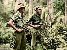 Australian soldiers,Private Leon Ravet (left) and PrivatebBernard Kentwell,on patrol in the dense jungle during the New Britain Campaign.Both soldiers are carrying Australian Owen sub-machine guns. New Britain island, Papua New Guinea 4 April Nagasaki, Hiroshima, Burma Campaign, Special Forces Gear, New Britain, Iwo Jima, Anzac Day, History Online, Military History