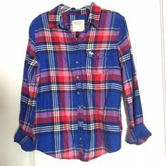 A&F Plaid Flannel ✨ Abercrombie & Fitch Plaid Flannel✨  • Long sleeve, plaid button down flannel from A&F • Size M • Blue, pink, red, yellow, and white moose logo • Beautiful pattern for the Christmas holidays! • Great condition, gently used • Make an offer if interested! :) feel free to ask questions! Abercrombie & Fitch Tops Button Down Shirts