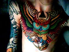 stunning colour work, owl chest piece tattoo. - not a huge owl fan but love the colors and the hourglass