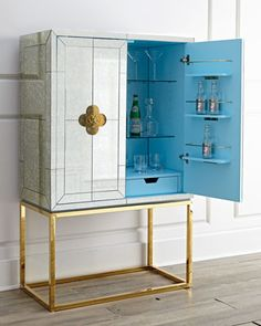 Delphine Mirrored Bar by Jonathan Adler at Horchow. Perfect combination of brass , bright color and  mirrored furniture.
