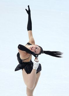 Kaetlyn Osmond of Canada competes in the Figure Skating Team Ladies Short Program during day one of the Sochi 2014 Winter Olympics at Iceberg Skating Palace on February 8, 2014 in Sochi, Russia.