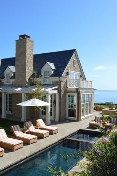 Classic East Coast-style home and lap pool overlooking the ocean.