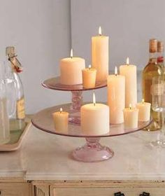 Use cake stands as platforms for votive and pillar candles (on a doily to protect the plate)