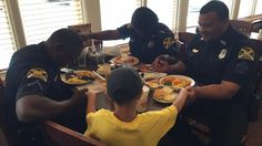 Powerful Photo Shows Little Boy Praying With Police Officers