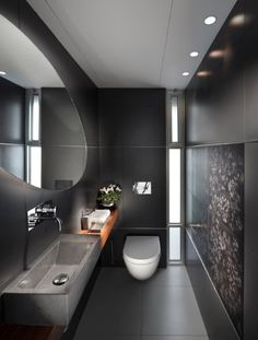 16 Almost Pure Black Bathroom Design Ideas : Small Bathroom With Black Wall Color And Rectangle Sink With Oval Mirror Design Bathroom Trends, Bathroom Interior, Design Bathroom, Bathroom Ideas, Sink Design, Bathroom Layout, Bath Ideas, Bathroom Remodeling, Bathroom Mural