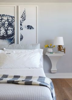Graphic sea turtle art provides interest above the bed in the master bedroom suite.- Cottage Style ® / Photo: Laura Moss / Design: Barbara Bottinelli