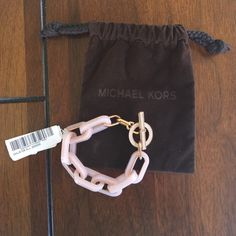 """Michael Kors RoseGold Acetate Pave Toggle Bracelet Brand new with tags! Blushing link design with shimmering pave clasp. Length is approx 7.5"""". Style Number: MKJ5109. Comes with MK protective jewelry pouch. No trades. No PayPal! Michael Kors Jewelry Bracelets"""
