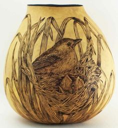 Nest with birds. Gourd by pirography.