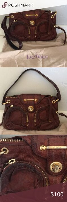 Botkier Bianca Bella small bag This bag is made of lambs skin. It is especially soft and rich in a brown red color. The zippers and accent pieces are gold.it can be a small over the shoulder bag or the handle unsnaps to attach to on side only for a large clutch. The inside is tan with some small areas of wear. Botkier Bags Shoulder Bags