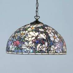 Magnolia Tiffany pendant by Interiors 1900 A traditional Tiffany design of Magnolia flowers depicted in beautifully bright vaseline glass. This pendant shade can also be hung inverted with a different fitting, please enquire. H:500-1535 W:400 D:400 Bulbs:1 x 60 E27 Fittings:SU02 Shade:T010SH40