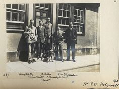 L-R Henry Russell Bowlby, Norman Fairbanks Smith, Arthur Cecil Kirby, Robert McGowan Barrington-Ward (all Balliol 1909), Whitney Hart Shephardson (Balliol 1910) and Saul the Airedale. Undergraduates in front of their digs at no.20, Holywell Street, aka the Misses Walkers' lodging house. c. 1910