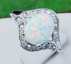White Opal ring.. For an engagement ring but with diamond in the center and opals around it