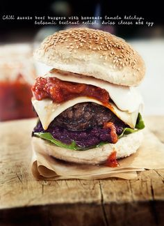 chili aussie beef burger with homemade tomato ketchup, balsamic beetroot relish, swiss cheese and egg.