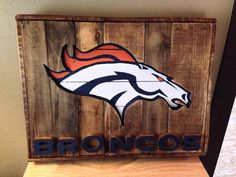 Denver Broncos Recycled Pallet - bet I could do this! Denver Broncos Logo, Broncos Gear, Go Broncos, Broncos Fans, Wooden Pallets, Recycled Pallets, Pallet Benches, Pallet Couch, Pallet Tables