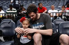 Kevin Love of the Minnesota Timberwolves spends time with a young lady from St. Jude Children's Research Hospital.