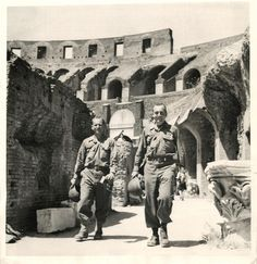 U.S. soldiers sightseeing in the Coliseum as they take a much needed rest after hard fight preceding entry into Rome. 1944