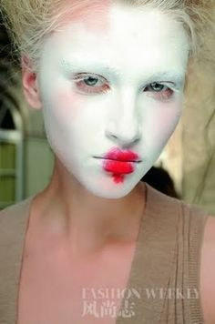 Vivienne Westwood's idea of a wonderful new look. Right. When I was 4 I did a better job! Plus, she should do something about that case of pink eye that seems to be spreading.