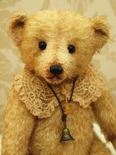 I love vintage toys and teddy bears. Take that doily thing off though. :/