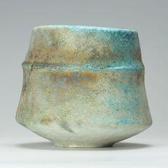 Orange/turquoise ribbed bowl by Jack Doherty