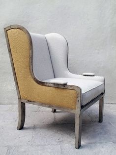 Ixelles chair, wingback with an iron base and upholstered seat