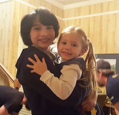 "Finn Wolfhard with one of the Price Twins behind the scenes of ""Stranger Things 2"" (2017)"