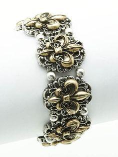 Silver and gold tone stretch Fleur de Lis Bracelet.