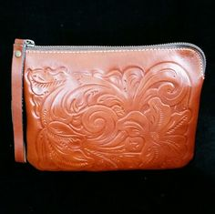 "PATRICIA NASH • Tooled Leather Wristlet NWT!💗HP💗 Patricia Nash Tooled Italian Leather Wristlet NWT! Gorgeous rich cognac color! Artisan tooled  floral design!  Zipper closure, 3 inside pockets, one is zipper closure, wristlet handle, 9"" x 7""  🚫No Trades🙄😘  ✔PRICE IS FIRM😗 🔘Please Ask ❓'s BEFORE you Buy🤔😃 💕Thank you for stopping by! Happy Poshing!💕 Patricia Nash Bags Clutches & Wristlets"