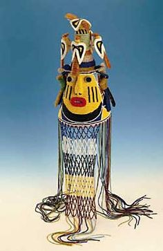 Yoruba Ade Oba / King's Beaded Crown A typical crown is cone-shaped and lavishly adorned with colourful beads, bird motifs and a beaded veil. Most crowns have a stylised face in the front that serves as the king's official face.
